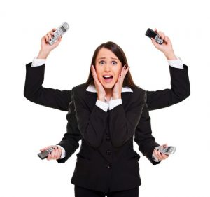stressed sales woman with telephones